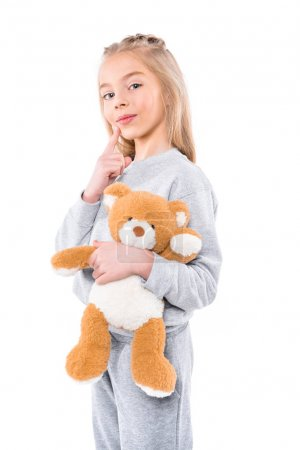 Smiling child with teddy bear