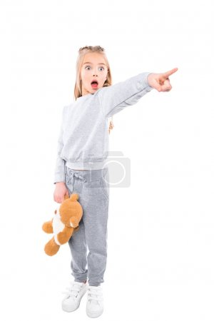 Shocked child pointing with finger