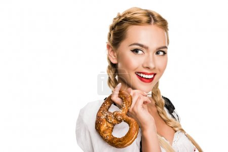 Photo for Beautiful girl in traditional german costume holding pretzel, isolated on white - Royalty Free Image