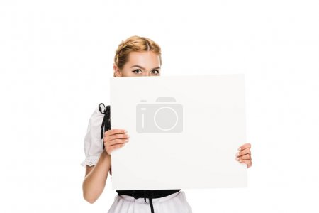 Photo for Beautiful girl in traditional german costume holding empty card, isolated on white - Royalty Free Image
