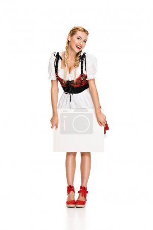 Photo for Attractive girl in traditional german costume holding empty card, isolated on white - Royalty Free Image