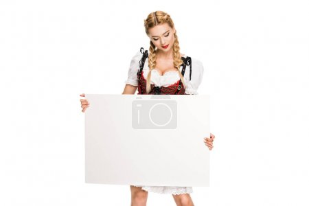 Photo for Blonde girl in traditional german costume holding empty template, isolated on white - Royalty Free Image
