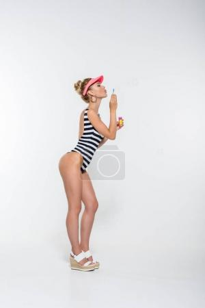attractive woman blowing soap bubbles