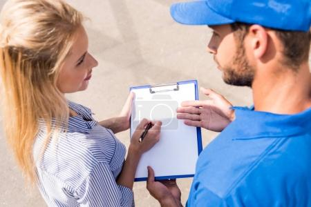 woman signing delivery document
