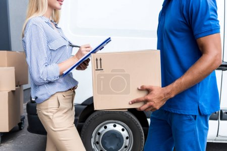 courier delivering packages for woman