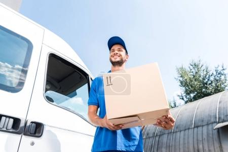 Photo for Bottom view of delivery man with cardboard box - Royalty Free Image