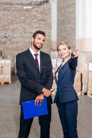 business colleagues at warehouse