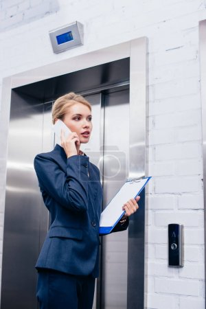 businesswoman talking by phone