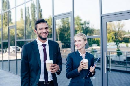 businesspeople walking with coffee