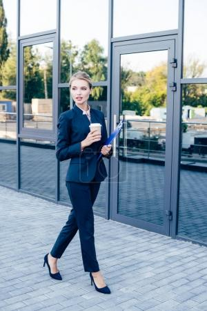 businesswoman with coffee and folder