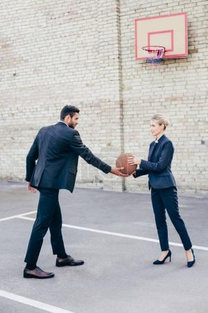 business colleagues with basketball ball