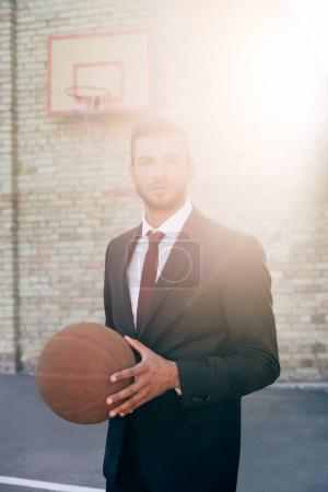 businessman with basketball ball