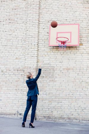 businesswoman playing basketball