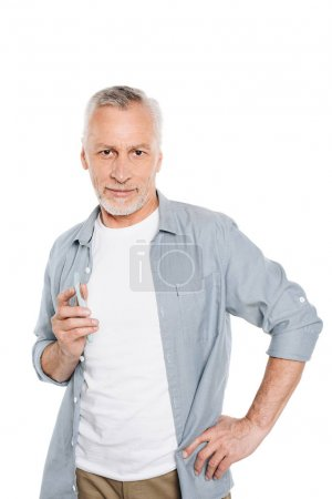 Photo for Portrait of handsome senior man holding smartphone and smiling at camera isolated on white - Royalty Free Image