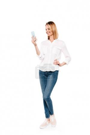 Photo for Full length view of happy young woman using smartphone isolated on white - Royalty Free Image