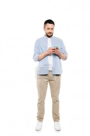 Photo for Full length view of handsome bearded man using smartphone isolated on white - Royalty Free Image