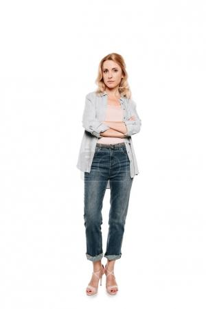 Photo for Confident blonde woman standing with crossed arms and looking at camera isolated on white - Royalty Free Image