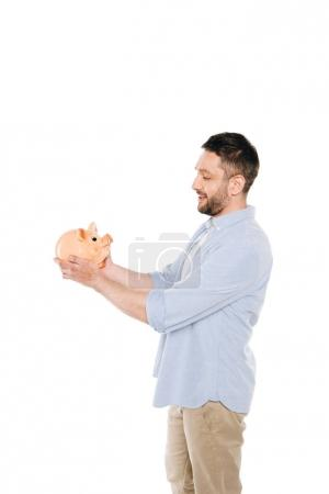 man holding piggy bank