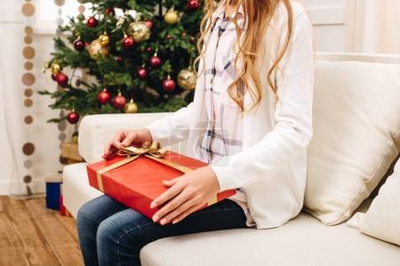 teenager with christmas present