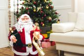 decorative santa with christmas gifts