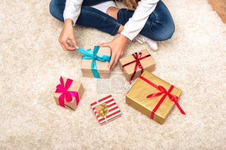 Teen with gift boxes