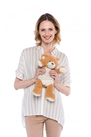 smiling woman holding teddy bear