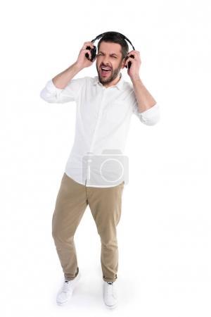 Man taking off headphones