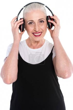 Senior woman in big headphones