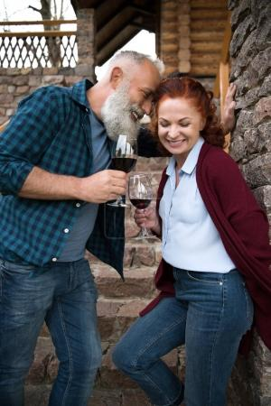 Mature couple drinking wine