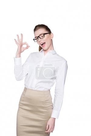 Photo for Beautiful young businesswoman showing okay sign isolated on white - Royalty Free Image