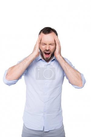 Photo pour Bâillement homme avec mal de tête tenant la tête avec les mains isolées sur blanc - image libre de droit