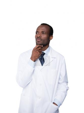 Photo for Thoughtful african american doctor looking away isolated on white - Royalty Free Image