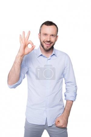 Photo pour Bel homme montrant ok signe isolé sur blanc - image libre de droit