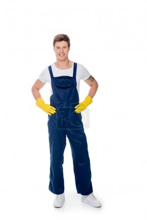 smiling cleaner standing akimbo
