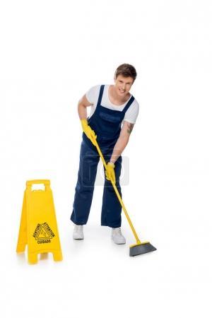 cleaner tidying floor with broom