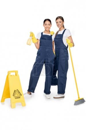 multiethnic cleaners in uniforms