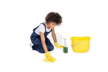 African american cleaner tidying floor