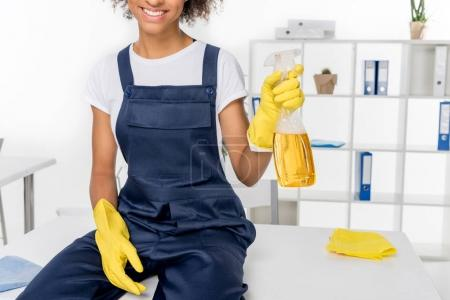 african american cleaner with spray bottle
