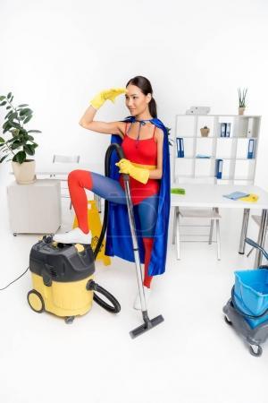 superhero with vacuum cleaner