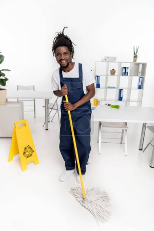 african american cleaner with mop