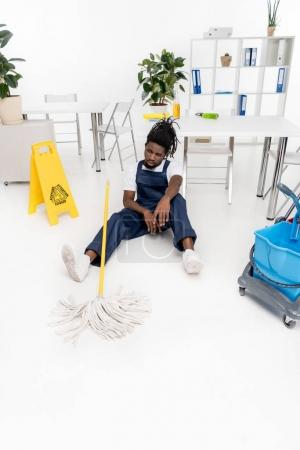 tired african american cleaner
