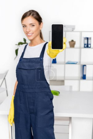 Young housekeeper with smartphone