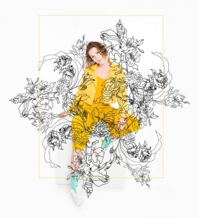 Photo for Floral illustration in frame over attractive young girl dressed in all yellow isolated on white - Royalty Free Image