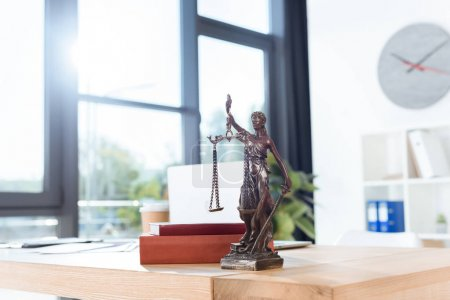 lawyer workplace with themis sculpture