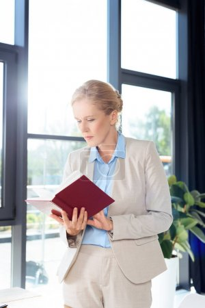 businesswoman reading book
