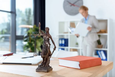 themis sculpture on table