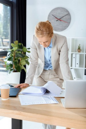 businesswoman with lot of paperwork