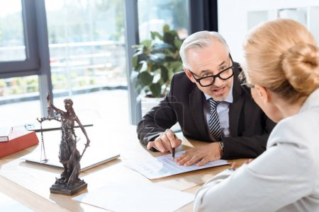 colleagues discussing contract