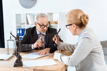 Lawyers discussing contract