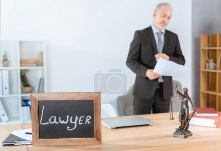 lawyer workplace with themis statue